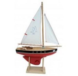 Voilier en bois navigable sur bassin,  coque de couleur rouge, voile blanche, fabriqué en France, 30 cm